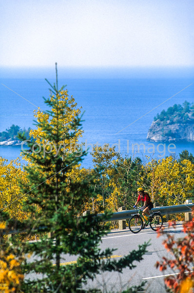 Biker on Canada's Hwy 17 (Trans-Canada Hwy) in Lake Superior Provincial Park north of Sault Ste  Marie - 1-Edit - 72 ppi