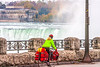 Touring cyclist viewing American side of Niagara Falls, NY-0586 - 72 ppi