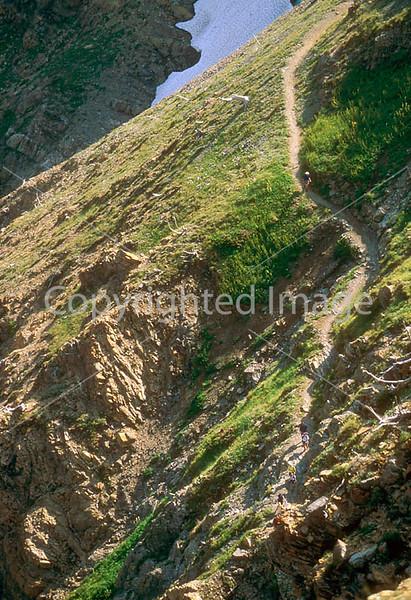 HI mt glacier 7 - ORps - jpeg - Hiker descending on Swiftcurrent Pass Trail in Glacier Nat
