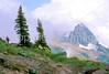 HI mt glacier 4 - ORps - jpeg - Hiker descending on Swiftcurrent Pass Trail in Glacier Nat