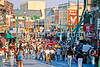 Cyclist pushing bike down middle of famed Beale Street in Memphis, Tennessee - 72 ppi