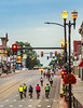 RAGBRAI 2014 - Day 7 - Riders at dawn pedaling out of downtown Independence, Iowa - C1-0085 - 72 ppi