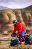 Winter bike tourer on dirt road in Oregon's John Day Fossil Beds Nat'l Monument - 72 ppi 10