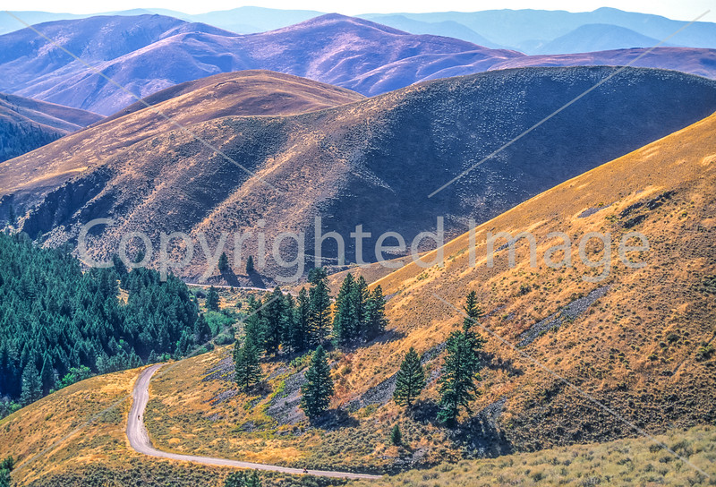 Biker on L&C Trail, on Idaho side of Lemhi Pass in Beaverhead Mts - 8-Edit - 72 ppi