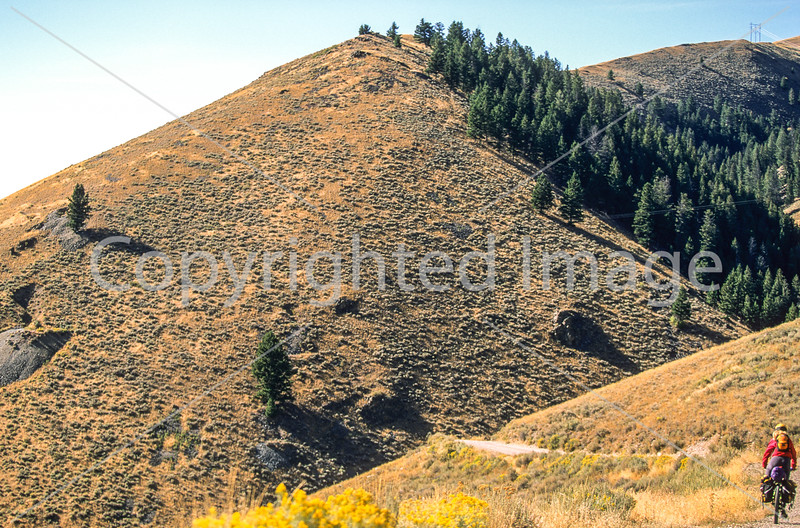 Biker on Lewis & Clark Trail, nearing Lemhi Pass on Montana-Idaho border - 1 - 72 ppi