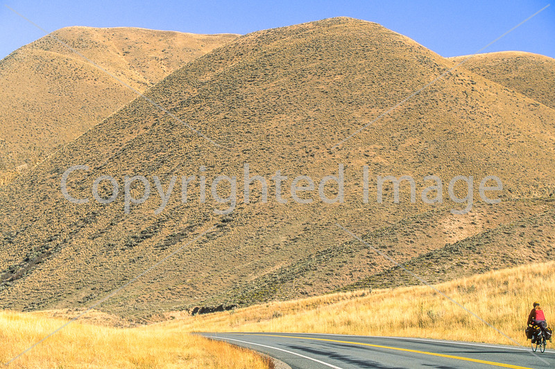 Lewis & Clark - Cyclist on ACA's route north of Salmon, Idaho, US 93, on Salmon River - 1-Edit - 72 ppi