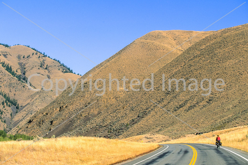 Lewis & Clark - Cyclist on ACA's route north of Salmon, Idaho, US 93, on Salmon River - 2-Edit - 72 ppi