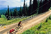 Touring cyclist(s) on Lolo Trail in Idaho's Bitterroot Mts; Forest Road 500 - 10 - 72 ppi