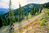 Touring cyclist(s) on Lolo Trail in Idaho's Bitterroot Mts; Forest Road 500 - 20 - 72 ppi