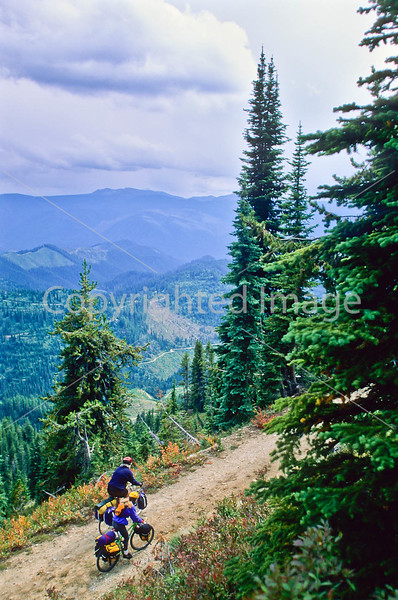 Touring cyclist(s) on Lolo Trail in Idaho's Bitterroot Mts; Forest Road 500 - 14 - 72 ppi