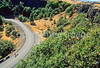 Touring cyclist on Rowena Loops of Columbia Gorge east of Portland, OR - 11 - 72 ppi