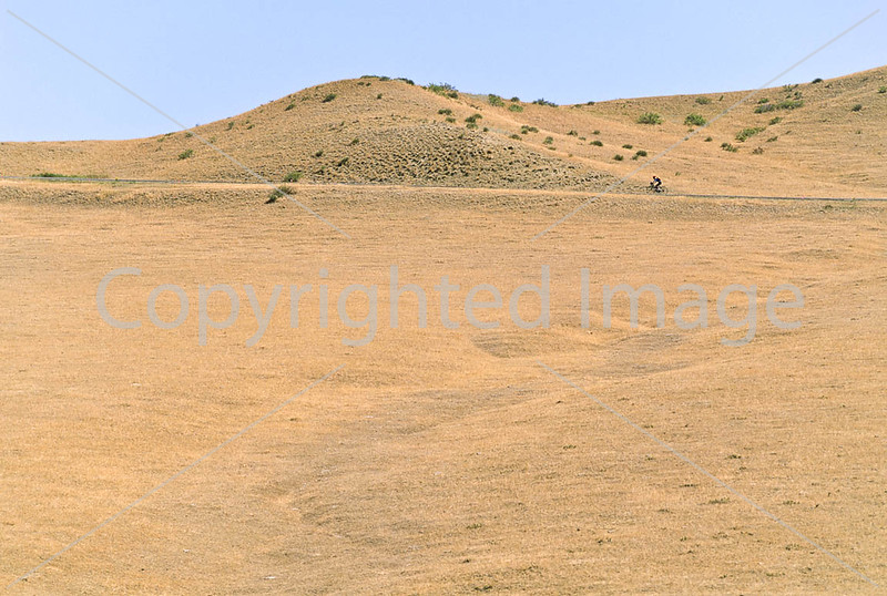 Cyclist at Little Bighorn Battlefield Nat  Monument in Montana - 8 - 72 ppi