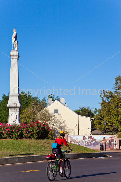 Cyclist at Confederate monument & Civil Rights mural in Port Gibson, MS - D1-C3-0275 - 72 ppi