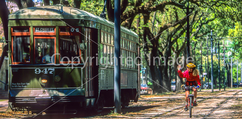 Cyclist & streetcar along St  Charles Avenue in New Orleans  - 1-2 - 72 ppi-2