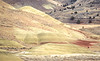 Winter bike tourer on dirt road in Oregon's John Day Fossil Beds Nat'l Monument - 72 ppi 7