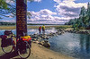 Cyclists walking across Mississippi River headwaters at Lake Itasca, MN - 9-Edit - 72 ppi