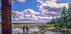 Cyclists walking across Mississippi River headwaters at Lake Itasca, MN - 9-Edit-Edit - 72 ppi
