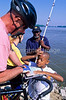 Cyclists meet fishermen at confluence of Mississippi & Missouri Rivers  - 2 - 72 ppi