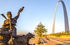 Cyclist, tourer, & Lewis & Clark statue on St  Louis waterfront - 72 ppi - 3