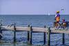 Touring cyclist on dock at Fairhope, Alabama, on Mobile Bay - 4-Edit - 72 ppi