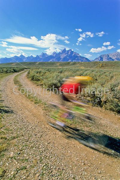 Biker on River Road along Snake River in Grand Teton NP - 27 - 72 ppi