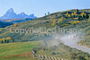 Biker eating dust on Gros Ventre Road Teton Nat'l Forest near Grand Teton Nat'l Park - rename 1 - 72 ppi
