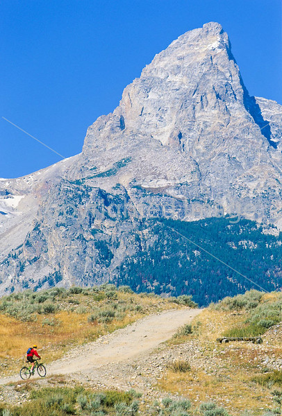 Mountain biker on south end of River Road along Snake River in Wyoming's Grand Teton NP - 15 - 72 ppi