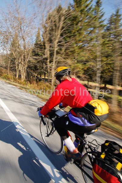 Biker nearing Frelighsburg, Canada, on ride from East Franklin, Vermont-C2--0057 - 72 ppi