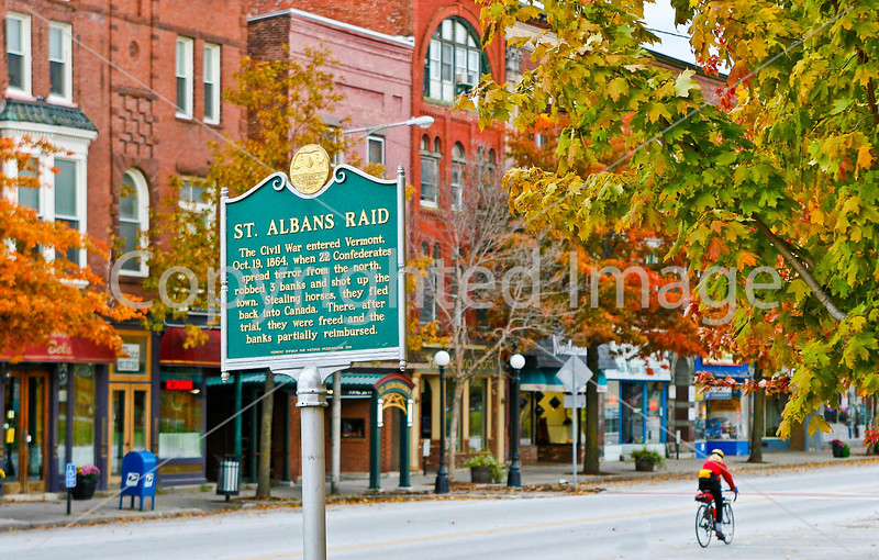 Cyclist on Main Street along Taylor Park in downtown St  Albans, Vermont-C3--0032 - 72 ppi