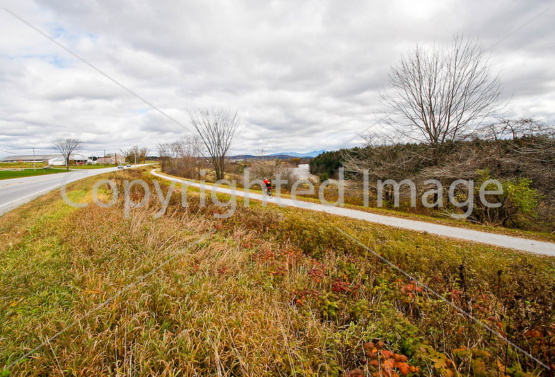 Cyclist on Missisquoi Valley Rail Trail west of Enosburg Falls, Vermont-C2--0250 - 72 ppi