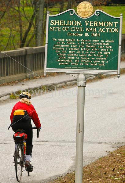 Biker on bank robbers' trail in Sheldon, VT-0230 - 72 ppi