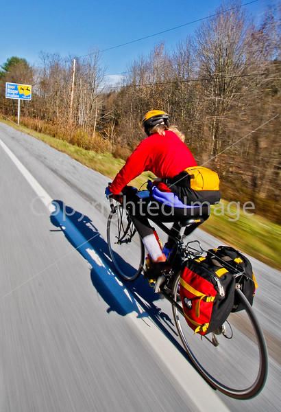 Biker nearing Frelighsburg, Canada, on ride from East Franklin, Vermont-C2--0061 - 72 ppi