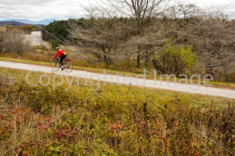Cyclist on Missisquoi Valley Rail Trail west of Enosburg Falls, Vermont-C2--0247 - 72 ppi