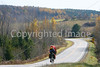 Biker nearing Frelighsburg, Canada, on ride from East Franklin, Vermont-C1--0023 - 72 ppi