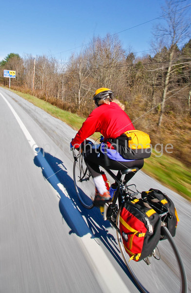 Biker nearing Frelighsburg, Canada, on ride from East Franklin, Vermont-C2--0059 - 72 ppi