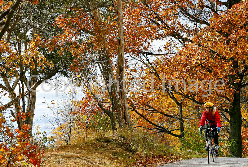 Cyclist at Kill Kare State Park on St  Albans Bay, Vermont-0200 - 72 ppi