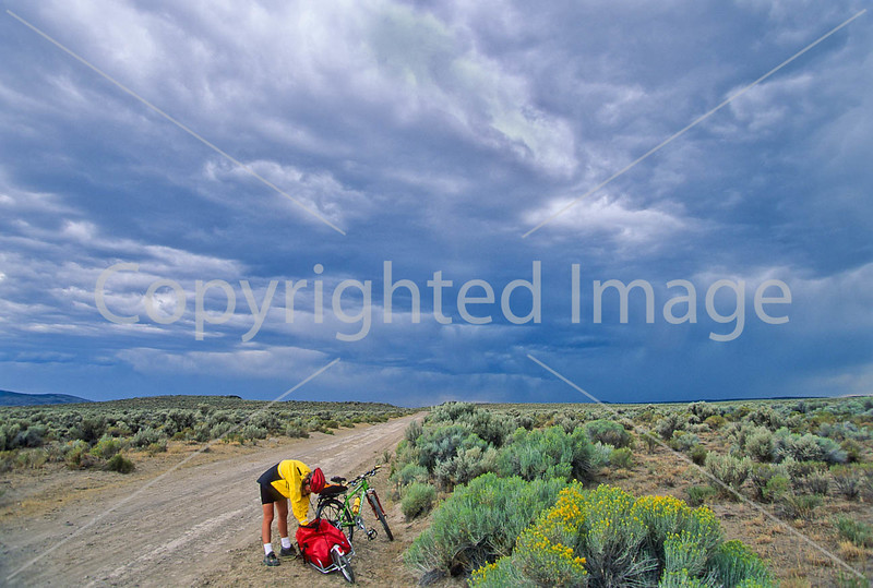 Tourer preparing for rain on Great Divide Trail near South Pass, Wyoming - 4 - 72 ppi