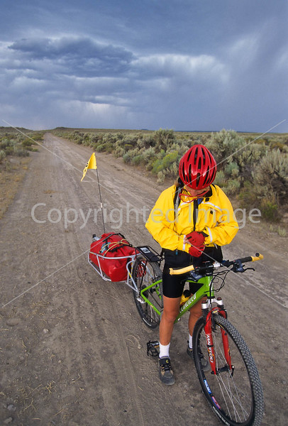 Tourer preparing for rain on Great Divide Trail near South Pass, Wyoming - 5 - 72 ppi
