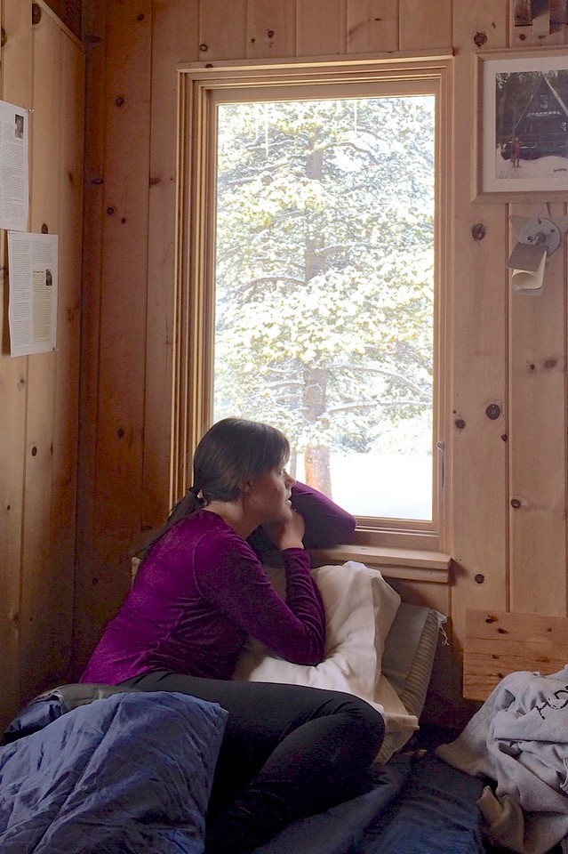 Sarah mesmerized by the snow. (anon photog)