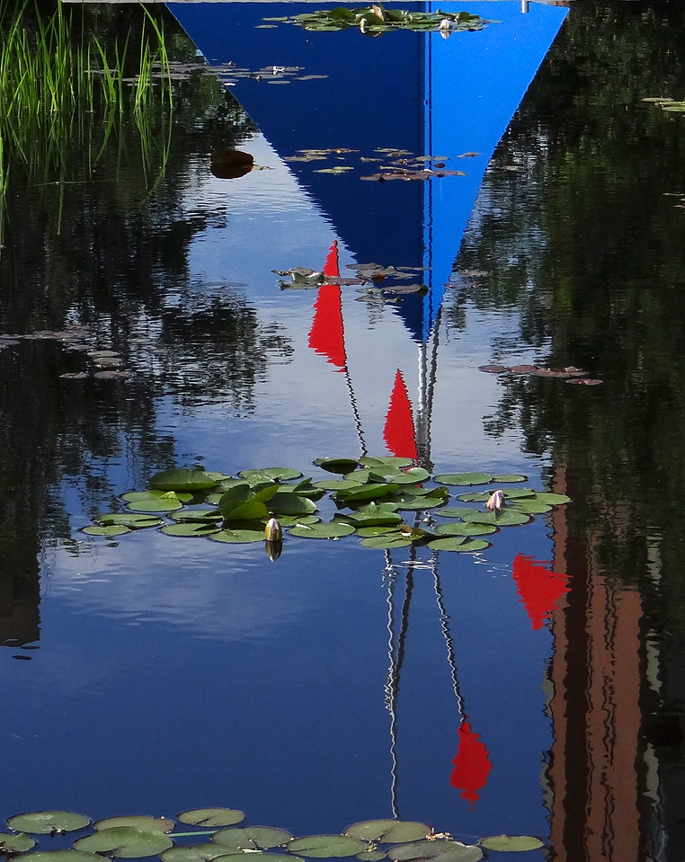 Calder sculpture reflection in lily pond