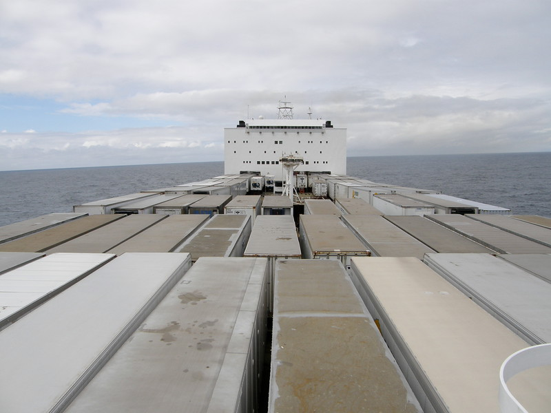 """From the bow, looking aft- note the roll even in calm seas. When we asked if we could explore this area, Frank  said """"Be careful, dammit- if those containers shift, they'll squash you like a bug."""""""