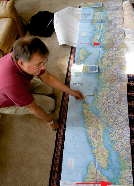 Bill plotting the two-week trip of a lifetime. We started at the lower red arrow (very bottom), ending in Ketchikan at the upper arrow. Exactly 700 nautical miles. (1 nautical mile = 6,076 feet)