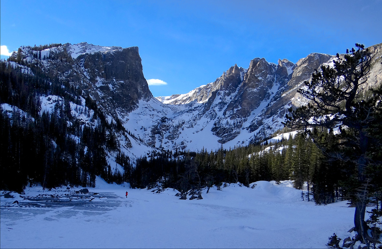 Red coat for scale. We were standing on Dream Lake in one of the most beautiful places in the world in Rcky Mtn Ntl Park.