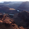 The mighty Colorado winds its way through the drama below Dead Horse Point