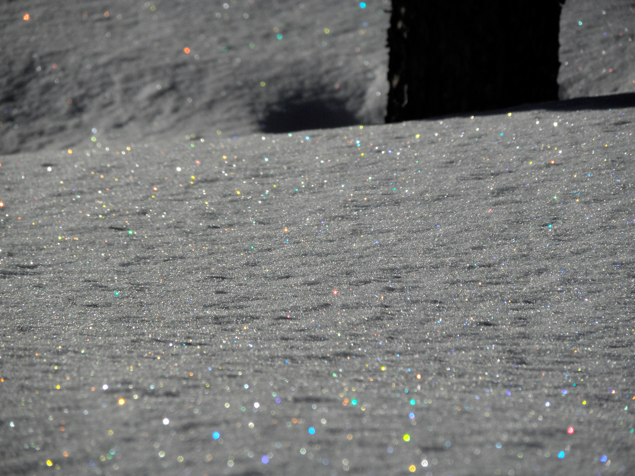 I have tried for years to get a good shot of the rainbow of reflections from individual snow flakes. This is as close as I've come.