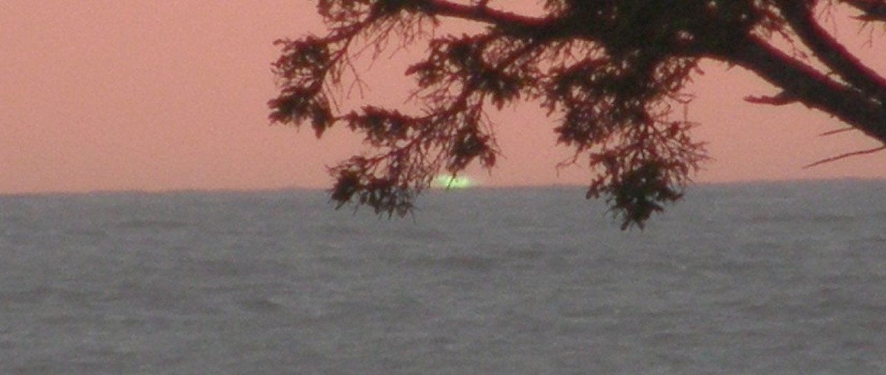 When I got back to Colorado and looked at my pictures, I was shocked to find I had inadvertently captured a rarely-seen phenomenon known as the Green Flash.  Not a great photo, but I'll take it.  https://en.wikipedia.org/wiki/Green_flash