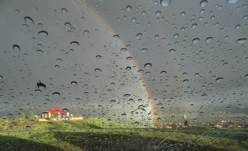 Intense double rainbow, but I couldn't get out of the car and get my camera wet!