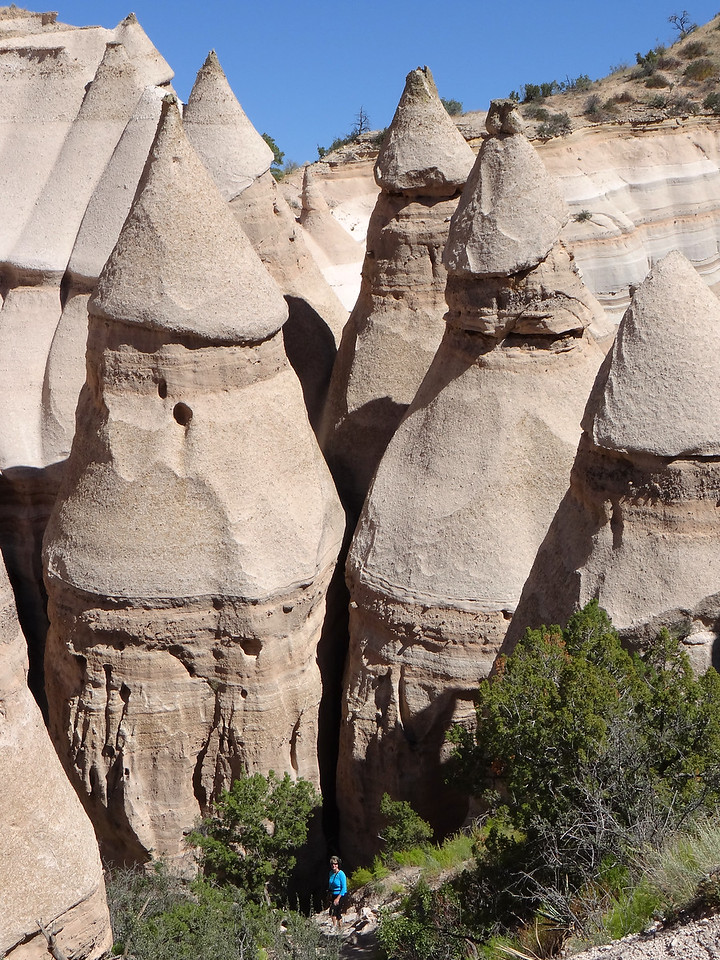 "That's Martha in blue. At one point someone in our party stared at these hoodoos for a while and pronounced,  ""I don't know who should be more excited by these- women or men!""  :^)"