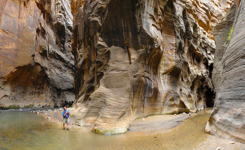 Here's Rick standing deep in the Zion Narrows, at the confluence of the Virgin River and Deep Creek, walls rising over a thousand feet on all sides.