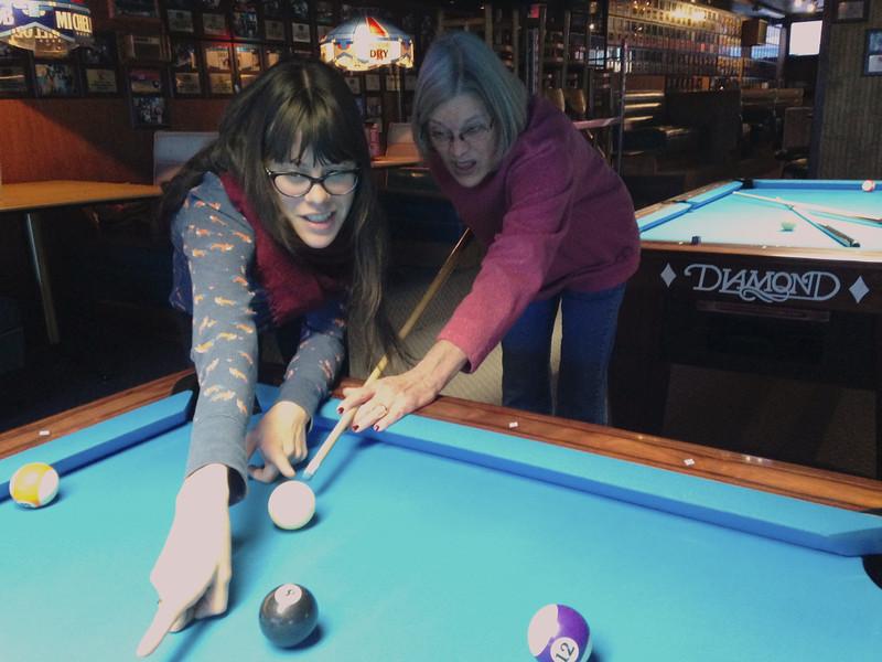 Sarah teaching Deda how to become a pool shark.